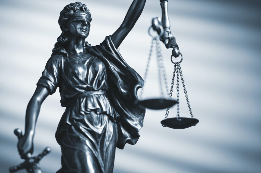 Figure of Justice holding scales and a sword